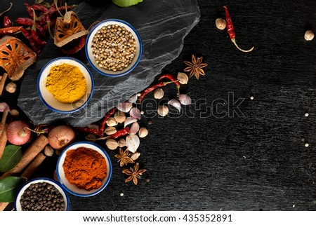 Various colorful spices on wooden table. healthy or cooking concept,  asian food