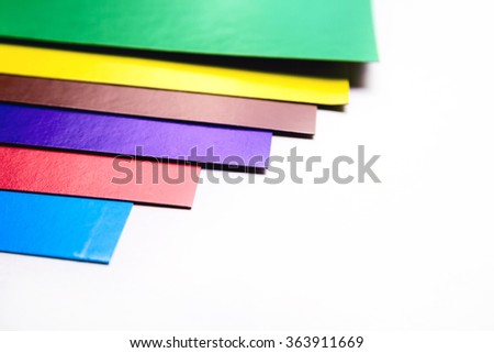 Various colors cardboard slices on white background