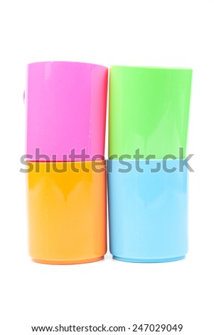 Various colors of glass are stacked. White background isolated. Taken in the studio