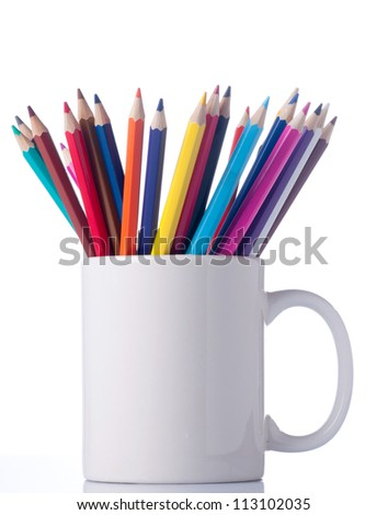 Various colour pencils in cup. Isolated on the white background. - stock photo