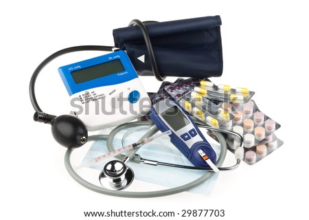 Various colour pills and medical tools on a white background