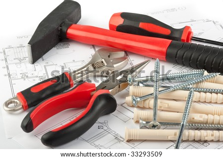 Various construction tools and blueprint of the house - stock photo