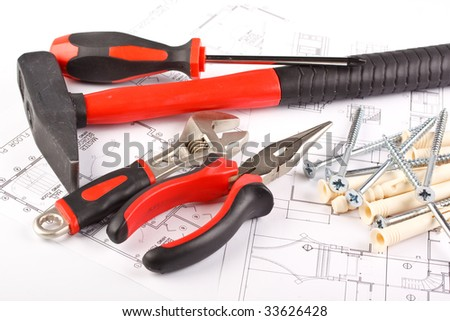 Various construction tools and blueprint of the house