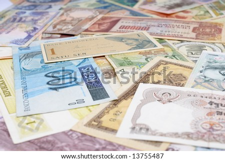 various currencies from countries spanning the globe. - stock photo
