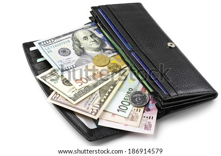 Various currencies in purse isolated on white background. - stock photo