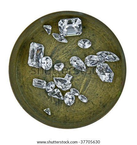 various cut cluster of diamonds in a working  brass box - stock photo