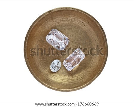 various cut cluster of diamonds in a working  brass tray, clipping path - stock photo