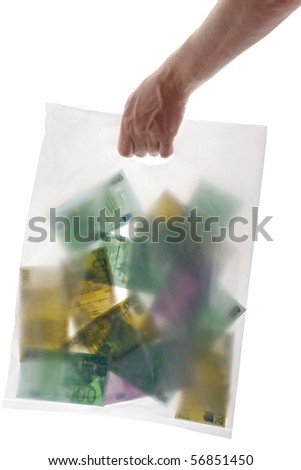 Various denominations of money euros in a transparent bag for purchases in hand. isolated on white - stock photo