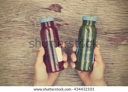 Various detox drinks in bottles. on white wooden background. Fresh organic Smoothie ingredients. Superfoods and health or detox diet food concept. - stock photo