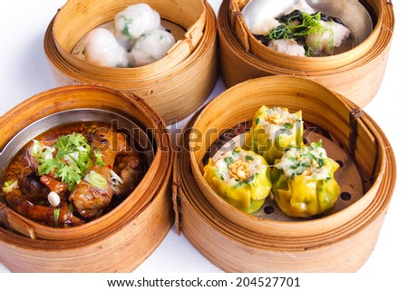 Various Dim Sum in Bamboo Steamed Bowl isolated white background - stock photo