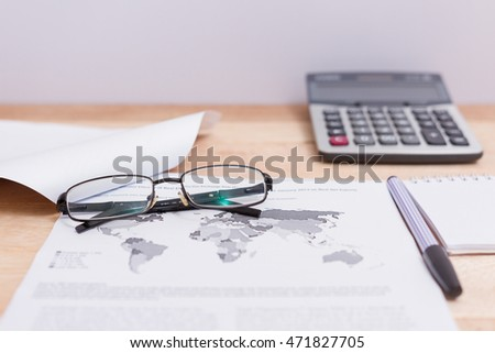 Various documents chart and glasses on the table
