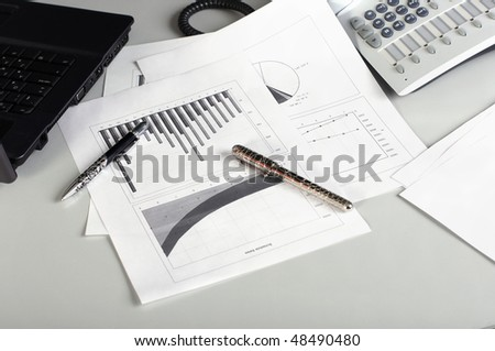 various documents chart and pens on the table