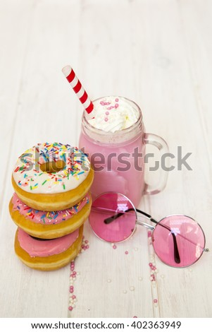 various donuts on kitchen table. summer concept - stock photo