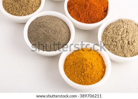 Various dried Indian spices in bowl - stock photo
