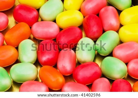 Various dry colourful sweets arranged as background