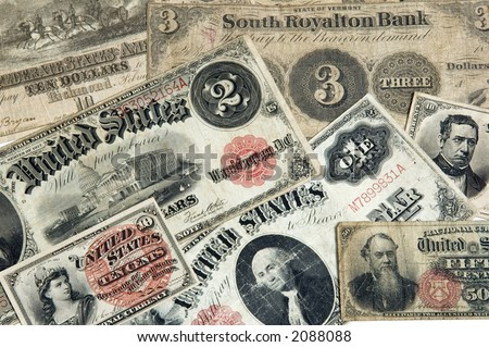 Various early American currency including one two three dollar bills 10 cents and fifty cent paper money - stock photo