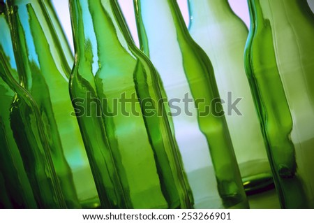 Various empty beer bottles in different assortments useful for recycling concepts - stock photo