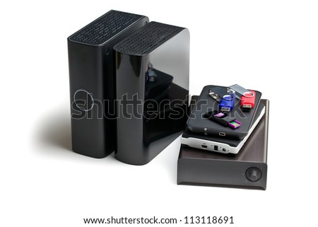 various external memory drive on white background - stock photo
