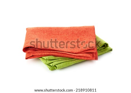 various folded cotton napkins isolated on a white background