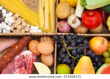 Various food full of proteins, meat, fish, eggs, cheese - stock photo