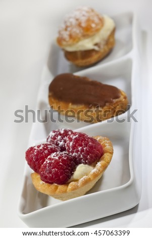 Various French pastries on a white porcelain dish