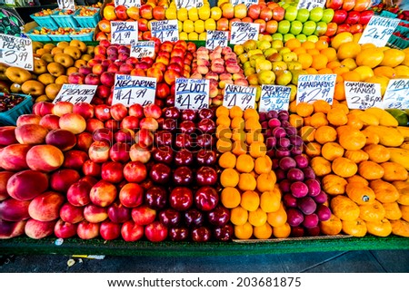 Various Fresh Fruit Being Sold at the Open Outdoor Market. - stock photo