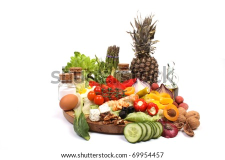 Various fresh products to make a healthy salad - stock photo