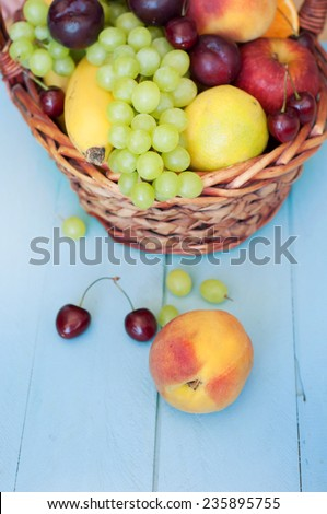 Various fresh ripe fruits placed in a wicker basket  - stock photo