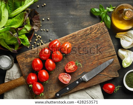 various fresh vegetables and spices on wooden table, top view - stock photo
