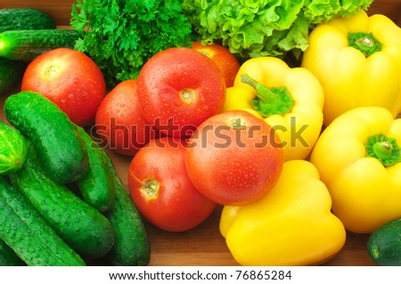 Various fresh vegetables in wooden tray. - stock photo