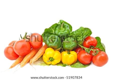 Various fresh vegetables on white background. - stock photo
