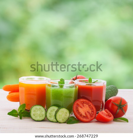 Various Freshly Squeezed Vegetable Juices for Detox. Summer background - stock photo
