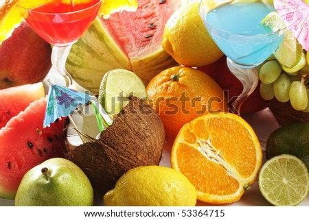 Various fruits in bulk and drinks above view photo
