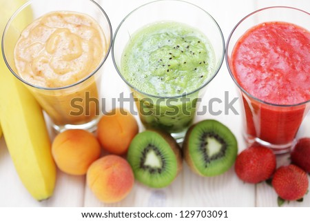 various fruity shakes with fresh fruits - food and drink - stock photo