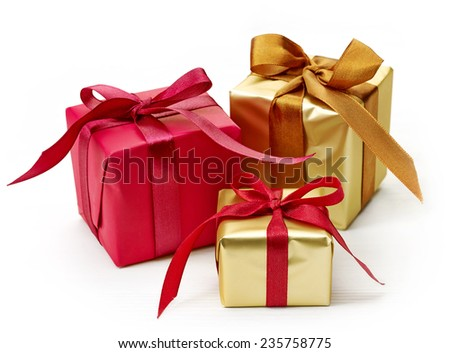 various gift boxes isolated on white wooden table - stock photo
