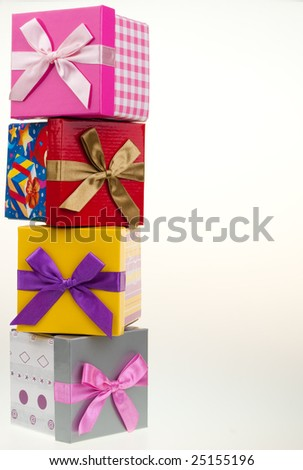 Various gift boxes on a white background, with bow