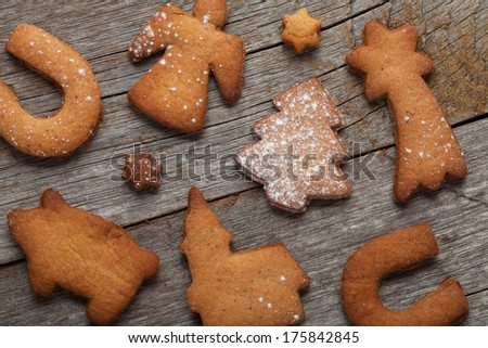 Various gingerbread cookies on wooden table background