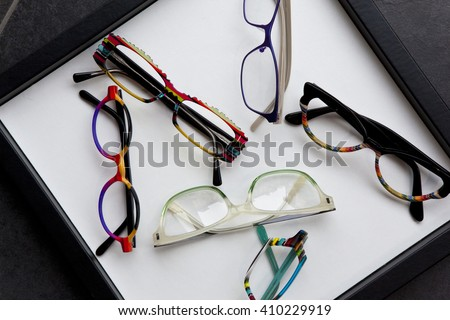 Various glasses on a tray in an optical shop