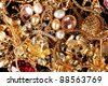 Various gold jewellery closeup - stock photo