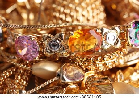 Various gold jewellery closeup - stock photo