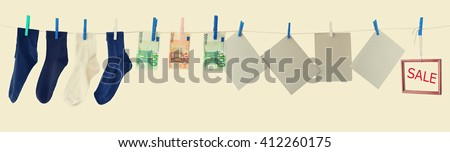 Various goods and things, hanging on a clothesline. Sale. Toned colors vintage image