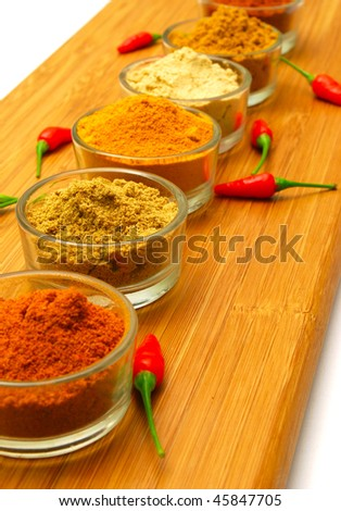 various  ground spices in rows - stock photo