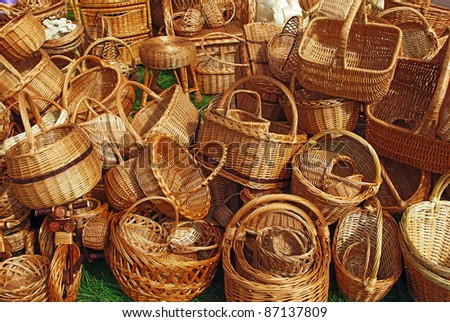 Various handmade baskets for sale at a souvenir market in Russia. - stock photo