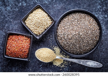 various healthy seeds collection on dark background, top view - stock photo