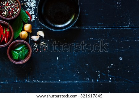 Various herbs and spices selection. Food and cuisine ingredients on dark vintage texture. Top view. Background with space for text. Colorful natural additives - stock photo