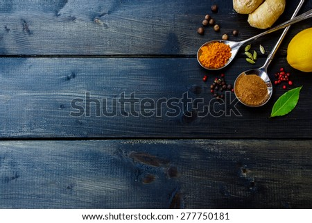 Various herbs and spices selection on dark wooden table, background with space for text. Top view. - stock photo