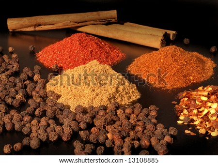 Various hot spices on a dark background. - stock photo