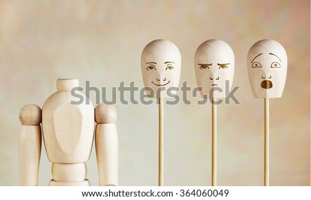 Various human emotions and mood. Abstract image with a wooden puppet - stock photo