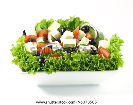Various ingredients in greek salad - stock photo