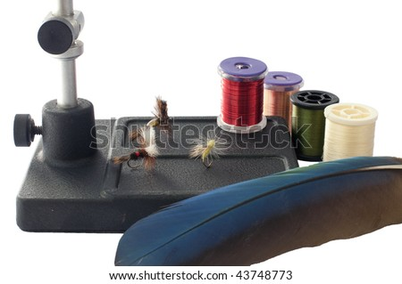 Various items for tying flies for fly fishing - stock photo